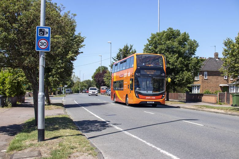 Newmarket Road Park and Ride bus; an orange double-decker bus, driving down Newmarket Road